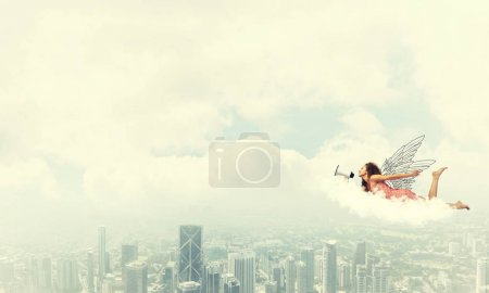 Young woman with megaphone flying