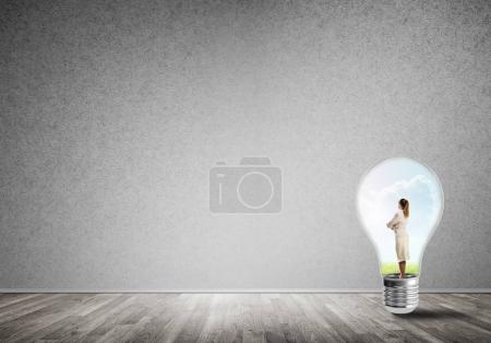Businesswoman trapped in bulb