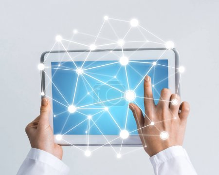 Tablet pc device in hands of doctor