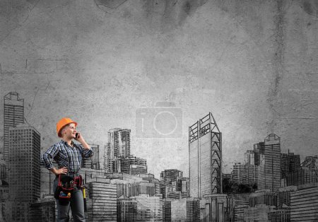 Engineer woman with cellphone