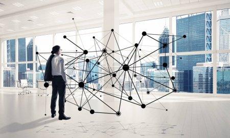 Elegant businessman in modern office interior