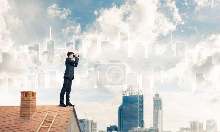 Businessman viewing cityscape