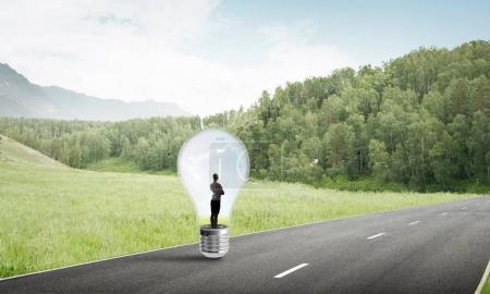 businesswoman trapped inside of light bulb