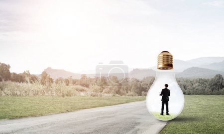 businessman trapped inside of light bulb