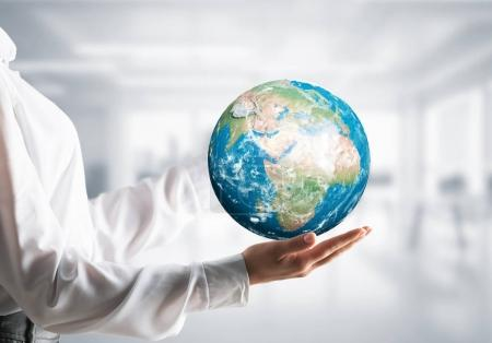 businesswoman holding Earth globe in hands