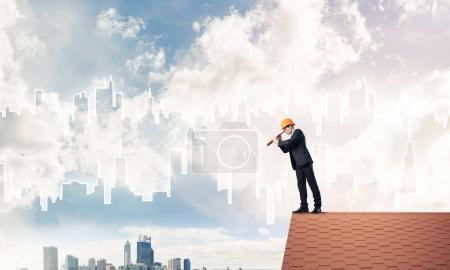 businessman in suit and helmet