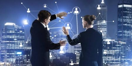 businessman and businesswoman standing with back and touching connection concept, Concept of social connection and networking