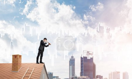 businessman in suit on roof edge
