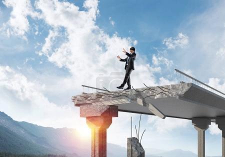 Businessman walking blindfolded