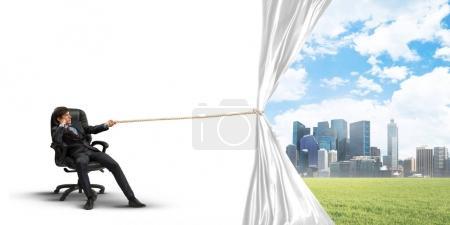 Businessman pulling white blank fabric