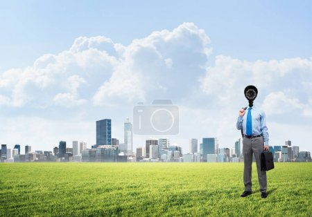businessman with camera instead of his head