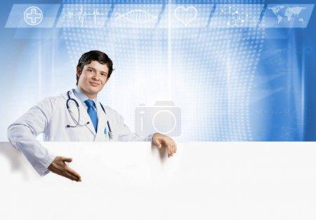 doctor holding white blank banner