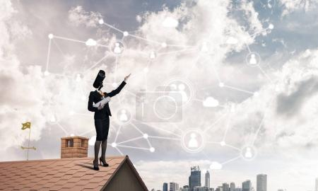 Faceless businesswoman with camera zoom