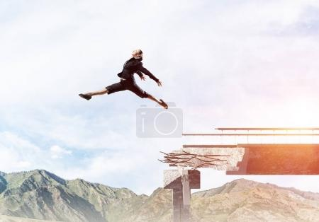woman jumping over huge gap