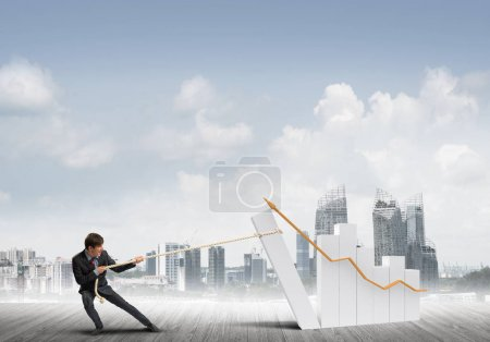 businessman making huge graph move