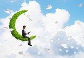 businessman floating on green moon