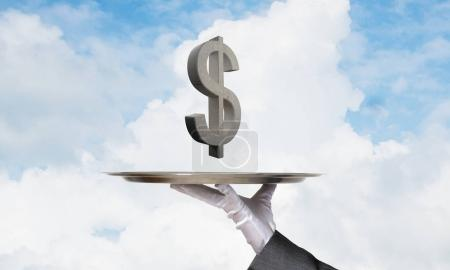 Cropped image of waiter hand in glove presenting stone dollar symbol on metal tray with blue cloudy skyscape on background, 3D rendering