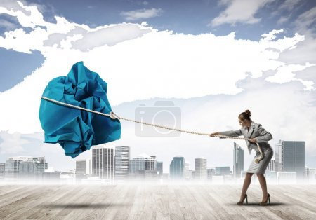 woman making paper ball move