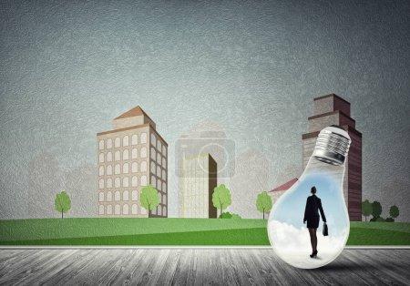 Businesswoman inside light bulb