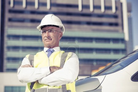 Confident construction engineer in hardhat