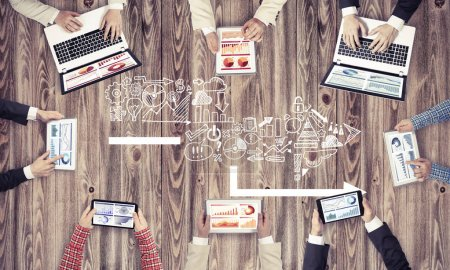 Group of people with devices in hands