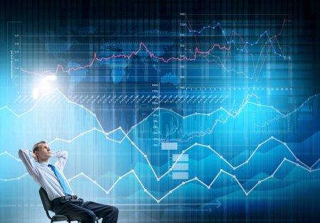 businessman looking at virtual panel
