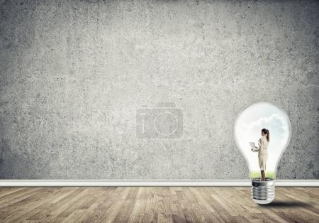 Businesswoman inside of light bulb