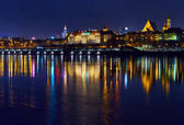 Warsaw, Poland - March 21, 2017: Great panoramic night view of the center and the Old City of Warsaw from the right bank of the Vistula River
