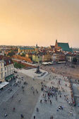 Warsaw, Poland - August 11, 2017: Beautiful aerial panoramic view of Plac Zamkowy square in Warsaw, with historic building, including Sigismund III Vasa Column, and people at summer sunset, Warsaw, Po