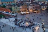 Warsaw, Poland - August 11, 2017: Beautiful aerial night panoramic view of Plac Zamkowy square in Warsaw, with historic building, including Sigismund III Vasa Column, and people at warm summer night W