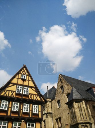 Facades of old buildings with cloudy sky