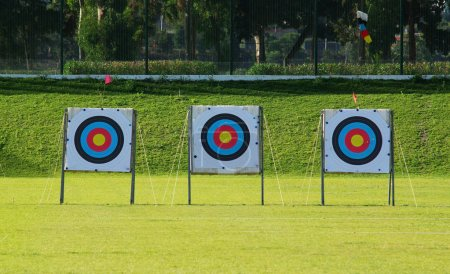 Three archery targets in row