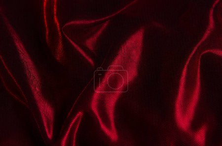 Background of red satin and black tulle with wrinkles and shadows