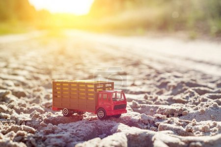 Photo for Toy retro truck on the road - a symbol of cargo transportation. sunset - Royalty Free Image