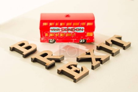 Photo for Britain exit from European Union, Brexit word abstract in vintage letters,background double decker bus toy model. - Royalty Free Image