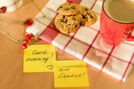 Photo for Sticker GOOD MORNING, DENTIST on the table at home. Background - tablecloth with a cup of coffee and cookies - Royalty Free Image