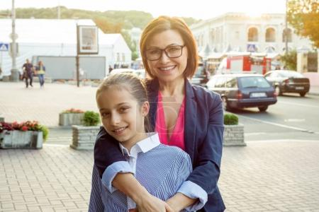Photo for Beautiful mom and her daughter are hugging and smiling. - Royalty Free Image