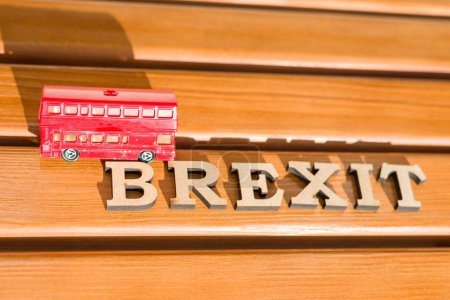 Britain exit from European Union, Brexit word abstract in vintage letters,background double decker bus toy model.
