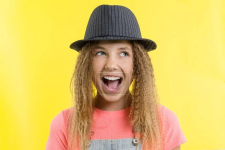 Photo for Delight, happiness, joy, victory, success and luck. Teen girl on a yellow background. Facial expressions and people emotions concept - Royalty Free Image
