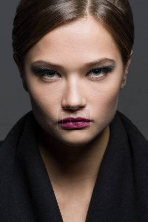 Photo for High fashion portrait of stylish young woman with evening make-up in black coat. - Royalty Free Image
