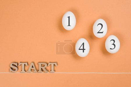 Photo for Abstract image. The word start and eggs on the way from start to finish. - Royalty Free Image