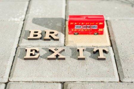 Photo for Kyiv, UA, 17.11.2017 Britain exit from European Union, Brexit word abstract in vintage letters,background double decker bus toy model. - Royalty Free Image