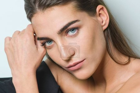 Photo for Fashion portrait of young beauty woman with clean skin, natural make-up, blue eyes, long straight healthy hair, sitting on white background - Royalty Free Image