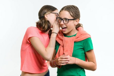 Photo for Portrait of two 12-13 year old girls. Beautiful teenage girlfriends communicate, secrete and smiling - Royalty Free Image