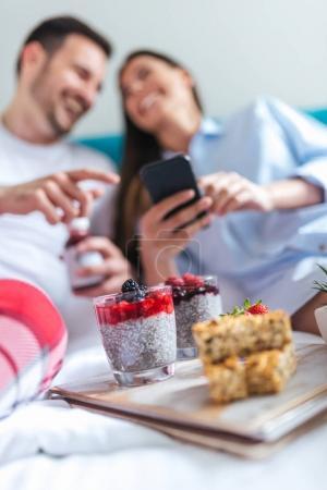 couple having breakfast on bed