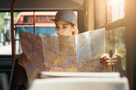 girl traveling and using map