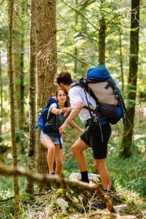 couple with backpacks walking