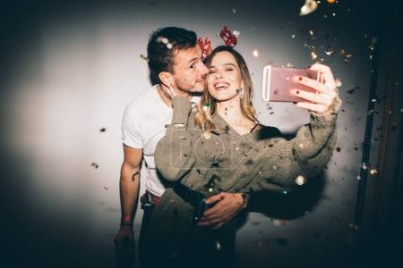 New Year's Party. Girl and boy taking selfie