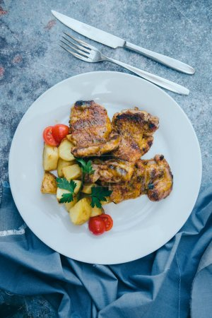 Photo for Close-up view of delicious meal with potatoes and meat in white plate - Royalty Free Image