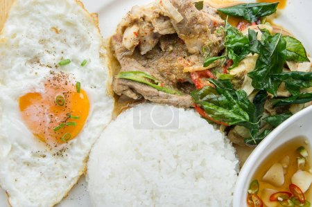 Grilled pork basil with Fried egg , stir basil with crispy pork , Kind of favarite Traditional Thai foods
